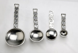pewter measuring spoons and cups